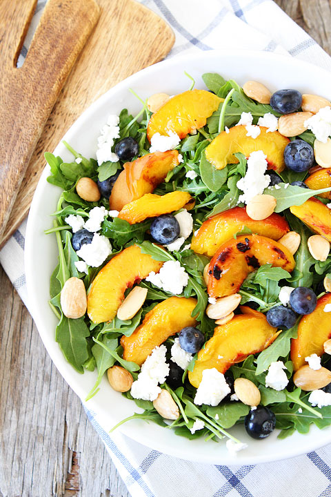 http://www.twopeasandtheirpod.com/grilled-peach-blueberry-and-goat-cheese-arugula-salad/